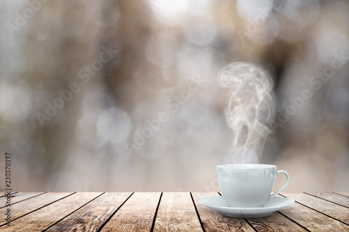 Fototapeta hot coffee on the table on a winter background obraz