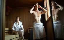 People In Bathrobes Using Sauna At Spa Resort