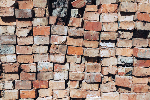 Pile of bricks. Old used texture. Close up picture. Fototapet