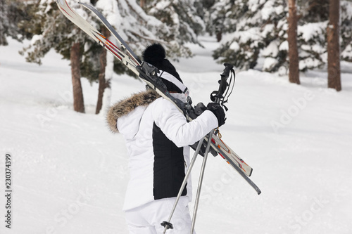 Woman with ski equipment on snow. Winter recreation