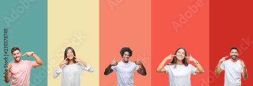 Fotomural Collage of different ethnics young people over colorful stripes isolated background smiling confident showing and pointing with fingers teeth and mouth