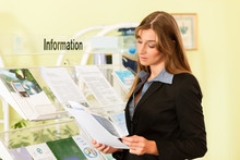 Young Businesswoman Standing I...