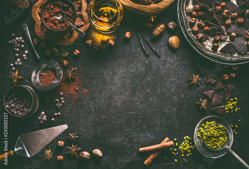 Fotografie, Obraz Dark chocolate background for confectionery or patisserie with broken crushed ch