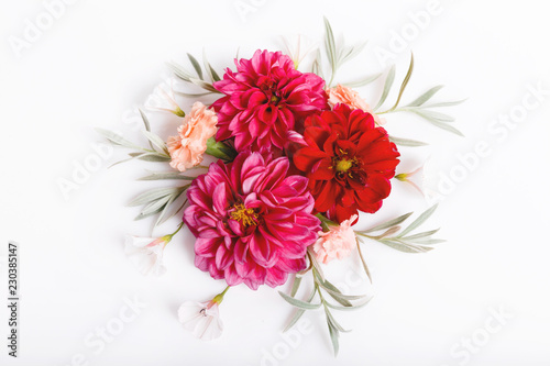 Festive flowers red dahlias composition on the white background. Overhead top view, flat lay. Copy space. Birthday, Mother's, Valentines, Women's, Wedding Day concept