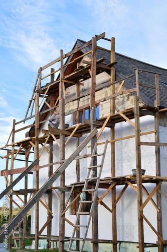 Wooden scaffolding next to white