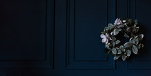 Advent Wreath With White Flowers And Christmas Decoration On Rustic Dark Blue Wall, Panoramic Format With Copy Space, Selected Focus, Narrow Depth Of Field