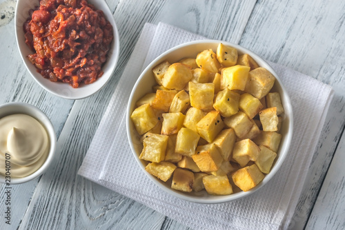 Canvas Portion of patatas bravas with sauces