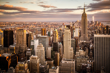 Panel Szklany Do kawiarni Beautiful sunset over skyline of New York City Midtown Manhattan
