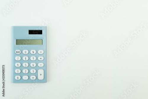 Cuadros en Lienzo  blue calculator white background  image close up.