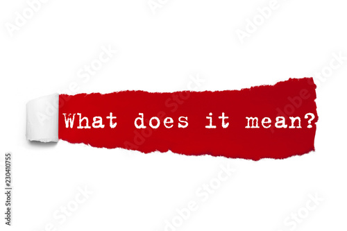 The text What does it mean written under the curled piece of Red torn paper Canvas Print