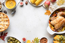 Thanksgiving Dinner With Chicken, Apple Pie, Pumpkin Soup Brussel Sprouts And Fruits.