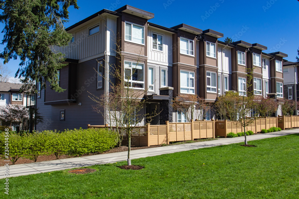 Fototapety, obrazy: Modern low rise wood frame complex. Brand new apartment building on sunny day in spring.