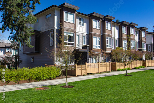 Foto op Plexiglas Stadion Modern low rise wood frame complex. Brand new apartment building on sunny day in spring.