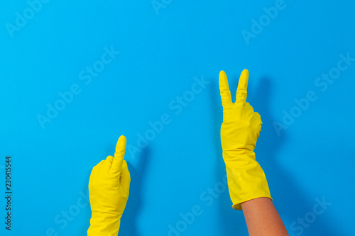 Woman hands with yellow rubber gloves making a gesture meaning victory and point Tapéta, Fotótapéta