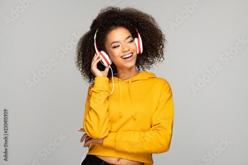 Young woman enjoying music - 230415939
