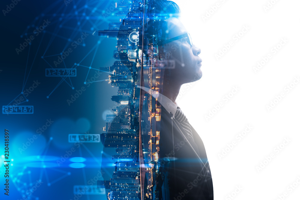 Fototapeta The double exposure image of the businessman thinking overlay with cityscape image and futuristic hologram. The concept of modern life, business, city life and internet of things