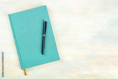 A photo of a teal blue journal with a pen, an elegant diary, notebook or planner Canvas Print