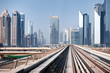 View from first railway carriage. Dubai city skyline panorama. Beautiful urban landscape of UAE in the day