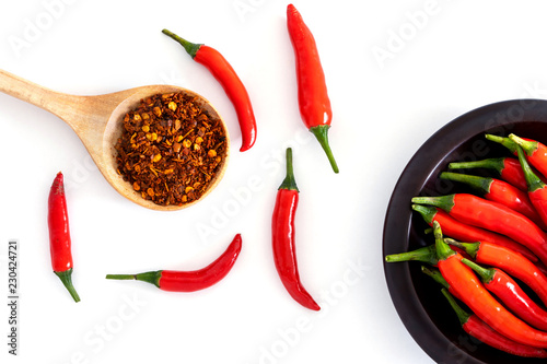 fresh red chilli pepper and crushed dried red cayenne pepper with a seeds , rich of antioxidant herbal food