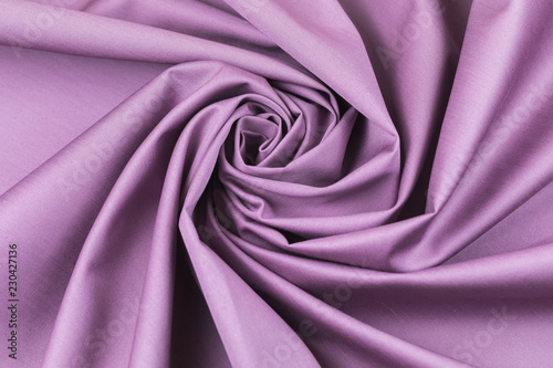 Fotobehang Stof The monophonic fabric of lilac color showing a beautiful drapery a spiral.