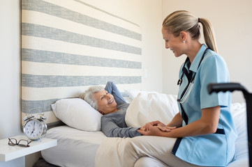 Fototapeta Nurse checking senior woman at home