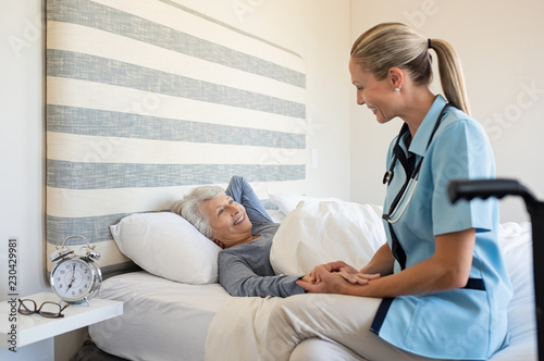 Obraz Nurse checking senior woman at home - fototapety do salonu