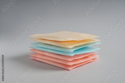 Fotografie, Obraz  Stack of menstrual pads on grey background