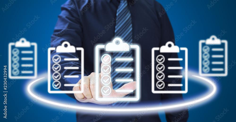 Fototapeta Businessman pressing check list icon over blue background. check list concept