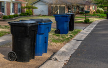 Suburban Trash Day Cans Out Fo...