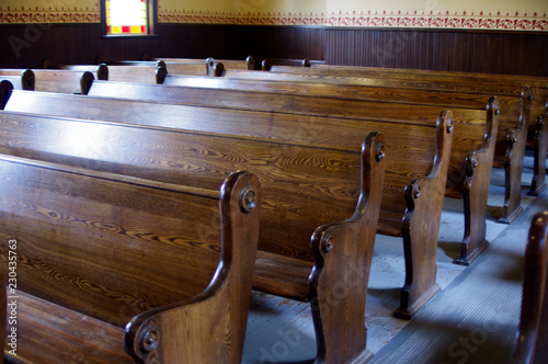 Canvastavla Carved Wooden pews in church
