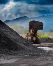 Coal: Loader Moving A Pile Of Coal At A Coal Mine On Vancouver Island