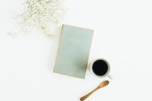 Female Desk With Coffee, Book, Flowers On White Background. Flat Lay, Top View.