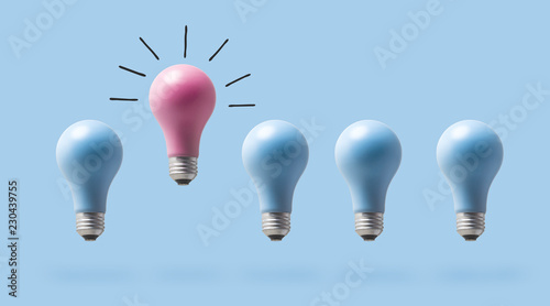 Fotografie, Obraz One outstanding idea concept with light bulbs on a blue background