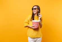 Laughing Happy Young Girl In 3d Imax Glasses Watching Movie Film, Looking Aside, Holding Bucket Of Popcorn Isolated On Bright Yellow Background. People Sincere Emotions In Cinema, Lifestyle Concept.