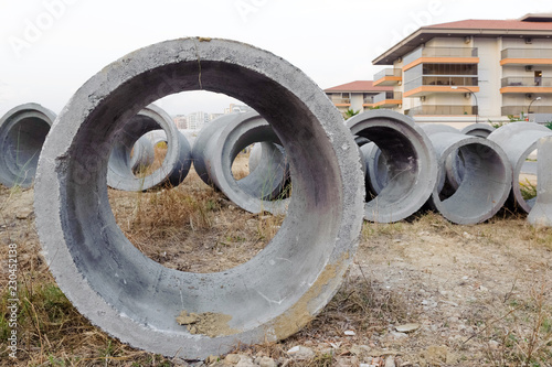 New concrete pipes (rings) are on the ground  In the