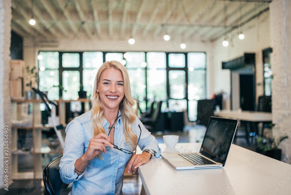 Fototapeta Portrait of successful entrepreneur at work.