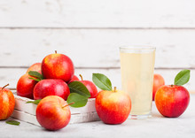 Glass Of Fresh Organic Apple Juice With Healthy Red Apples In Box On Wooden Background