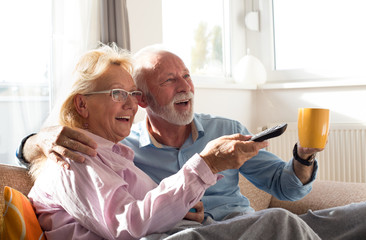 Fototapeta Senior couple watching tv
