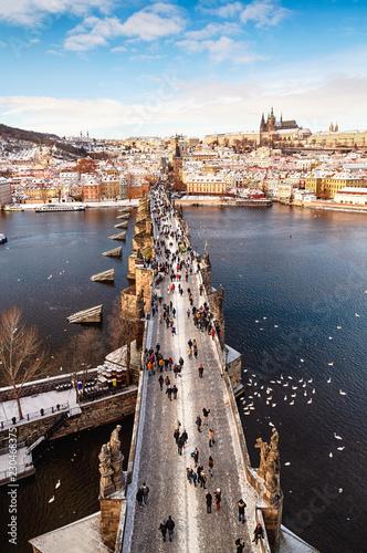 fototapeta na ścianę Charles Bridge is historic bridge that crosses Vltava river in Prague at winter, Czech Republic.