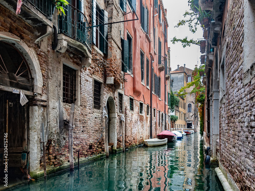 Fototapeta narrow canal in summer in venice obraz