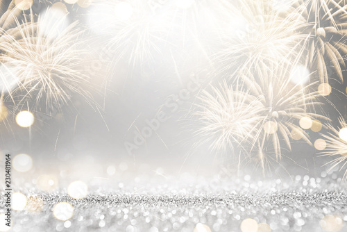 Fotografia  Gold and silver Fireworks and bokeh in New Year eve and copy space