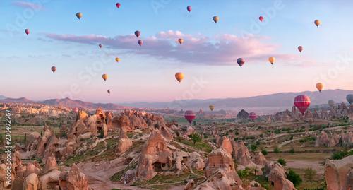 Hot air balloons over mountain landscape in Cappadocia Fototapet