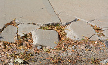 Broken Sidewalk Concrete In Ne...