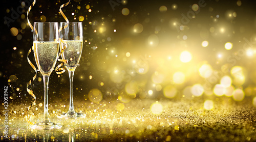 Champagne Flutes In Golden Sparkle Background - Happy New Year