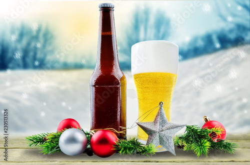 Beer in bottle and in glass with Christmas decoration