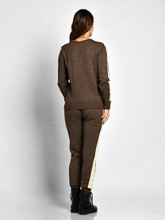 Young Beautiful Woman Posing In New Gray Fashion Winter Knitted Suit Full Body Back Side From Behind