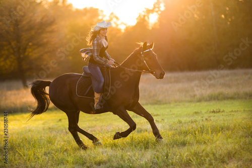 Poster Equitation Girl equestrian rider riding a beautiful horse