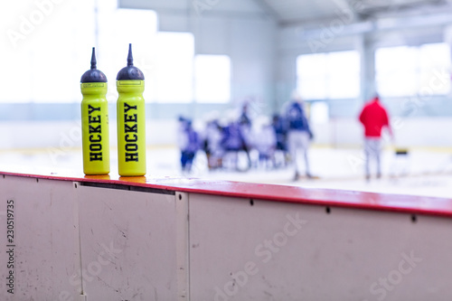 ice hockey rink, bottle on board