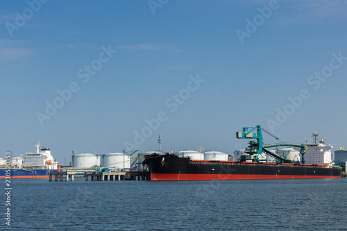 a chemical cargo port with ships in it