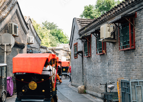 Fotografie, Obraz  Chinese old street Hutong and traditional rickshaw at Shichahai in Beijing, Chin